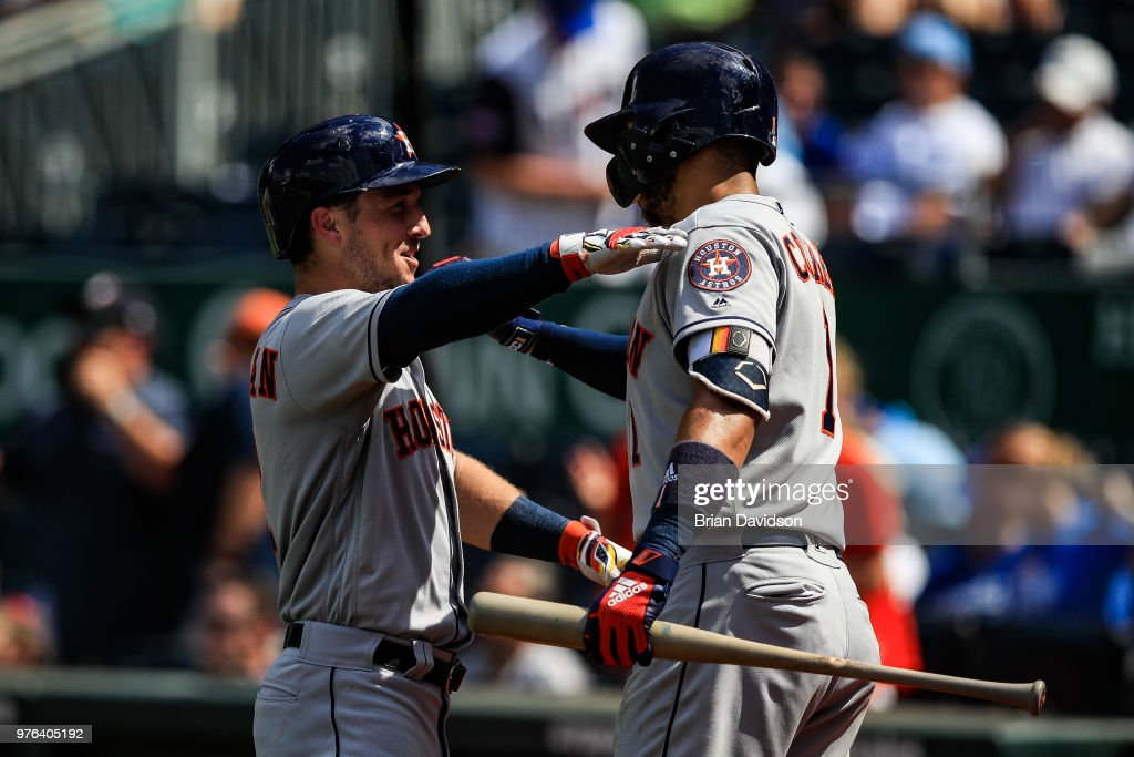 Alex Bregman #2 celebrates hitting a three run home run with Carlos Correa #1 of the Houston Astros against the Kansas City Royals during the ninth inning at Kauffman Stadium on June 16, 2018 in Kansas City, Missouri.