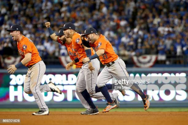 Alex Bregman Marwin Gonzalez Carlos Correa and Jose Altuve of the Houston Astros celebrate defeating the Los Angeles Dodgers 51 in game seven to win...