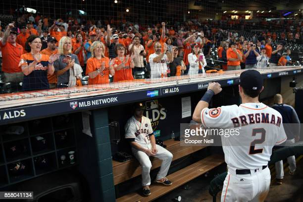 Alex Bregman of the Houston Astros acknowledges fans after Game 1 of the American League Division Series against the Boston Red Sox at Minute Maid...