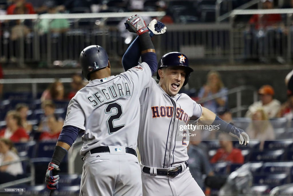 Alex Bregman #2 of the Houston Astros and the American League celebrates with Jean Segura #2 of the Seattle Mariners and the American League after hitting a solo home run in the tenth inning against the National League during the 89th MLB All-Star Game, presented by Mastercard at Nationals Park on July 17, 2018 in Washington, DC.