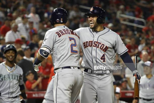 Alex Bregman of the Houston Astros and the American League celebrates with George Springer of the Houston Astros and the American League after...