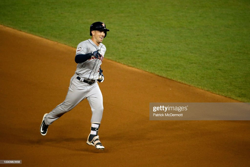 Alex Bregman #2 of the Houston Astros and the American League celebrates as he rounds the bases after hitting a solo home run in the tenth inning against the National League during the 89th MLB All-Star Game, presented by Mastercard at Nationals Park on July 17, 2018 in Washington, DC.