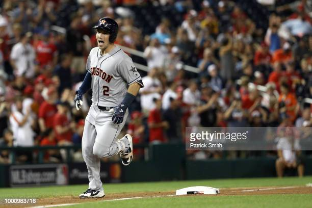 Alex Bregman of the Houston Astros and the American League celebrates as he rounds the bases after hitting a solo home run in the tenth inning...