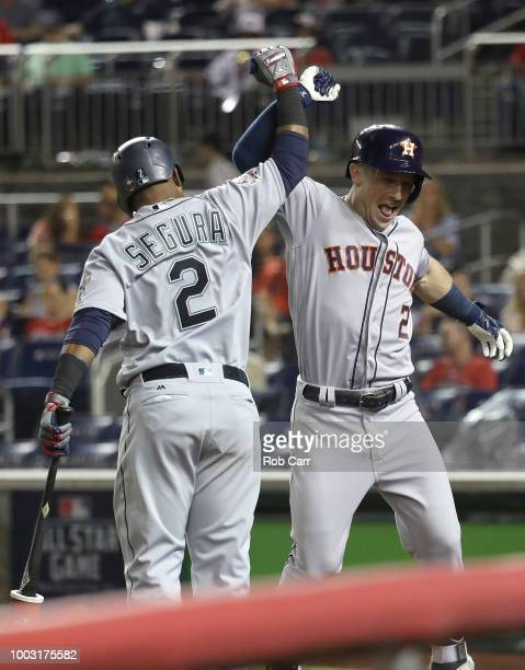 Alex Bregman of the Houston Astros and the American League celebrates with Jean Segura of the Seattle Mariners during the 89th MLB AllStar Game...