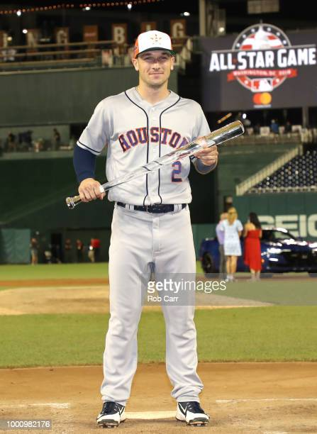 Alex Bregman of the Houston Astros and the American League poses with the MVP trophy after defeating the National League during the 89th MLB AllStar...