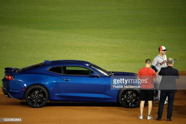 Alex Bregman of the Houston Astros and the American League stands with his Chevy Camaro after defeating the National League during the 89th MLB...