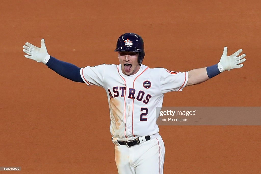 Alex Bregman #2 of the Houston Astros celebrates after hitting a game-winning single during the tenth inning against the Los Angeles Dodgers in game five of the 2017 World Series at Minute Maid Park on October 30, 2017 in Houston, Texas.
