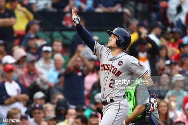 Alex Bregman of the Houston Astros celebrates after hitting a solo home run in the eighth inning against the Boston Red Sox during game four of the...
