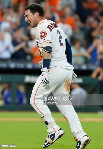 Alex Bregman of the Houston Astros celebrates after hitting a walkoff tworun home run in the ninth inning to give the Houston Astros a 76 win over...