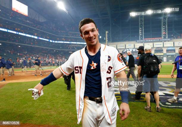 Alex Bregman of the Houston Astros celebrates after hitting the gamewinning single during the tenth inning to defeat the Los Angeles Dodgers in game...