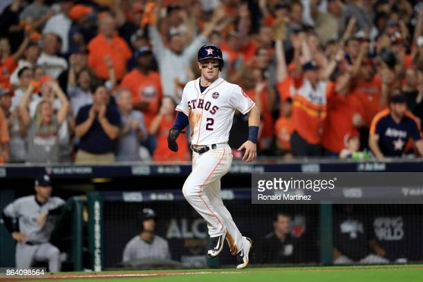 Alex Bregman of the Houston Astros celebrates after scoring off of Brian McCann RBI double against the New York Yankees during the fifth inning in...