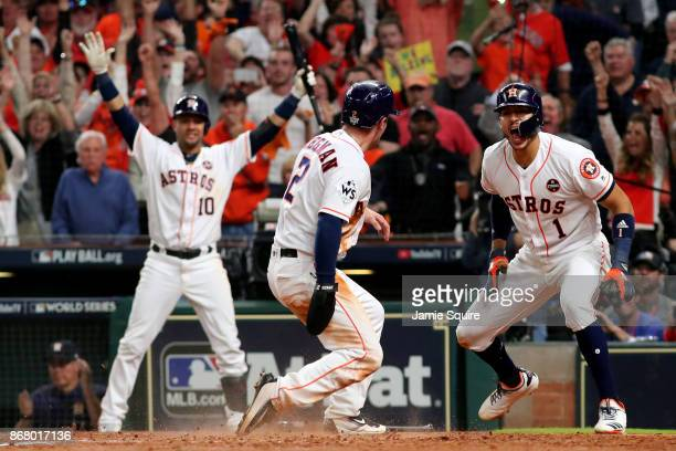Alex Bregman of the Houston Astros celebrates after scoring on a double by Jose Altuve during the seventh inning against the Los Angeles Dodgers in...