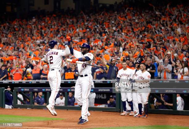 Alex Bregman of the Houston Astros celebrates his solo home run with Yordan Alvarez during the fourth inning of Game 2 of the ALDS against the Tampa...