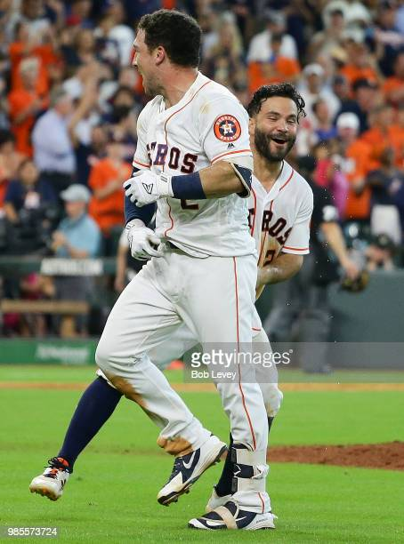 Alex Bregman of the Houston Astros celebrates his tworun walkoff home run in the ninth inning with Jose Altuve for a 76 win over the Toronto Blue...