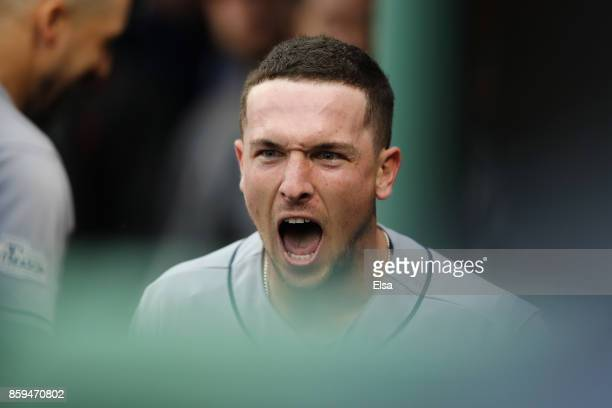 Alex Bregman of the Houston Astros celebrates in the dugout after hitting a solo home run in the eighth inning against the Boston Red Sox during game...