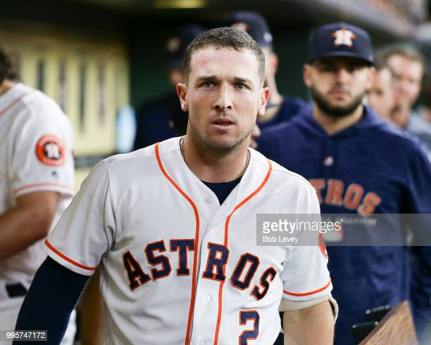 Alex Bregman of the Houston Astros celebrates in the dugout after hitting a home run in the first inning against the Oakland Athletics at Minute Maid...