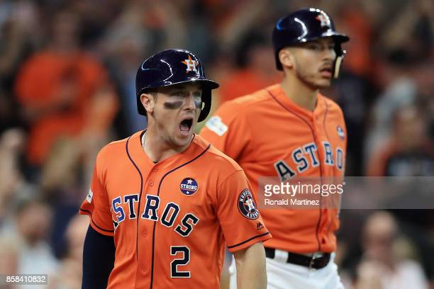 Alex Bregman of the Houston Astros celebrates scoring a run on an RBI single hit by Jose Altuve in the third inning against the Boston Red Sox during...
