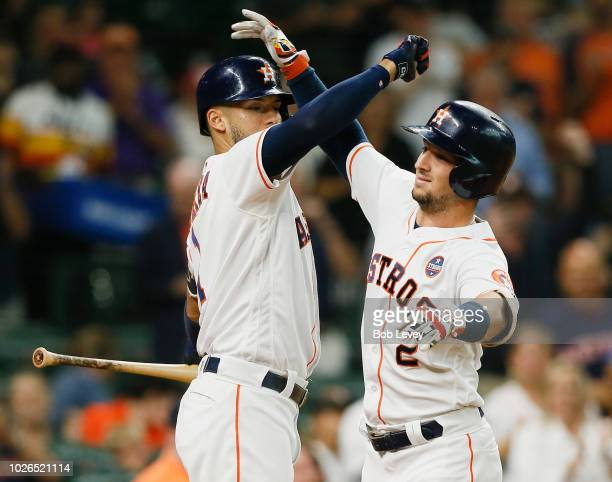 Alex Bregman of the Houston Astros celebrates with Carlos Correa after hitting a home run in the first inning against the Minnesota Twins at Minute...