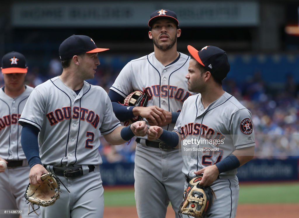 Alex Bregman #2 of the Houston Astros celebrates with Carlos Correa #1 and Jose Altuve #27 after getting the last out of the third inning during MLB game action against the Toronto Blue Jays at Rogers Centre on July 9, 2017 in Toronto, Canada.