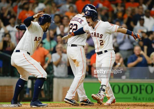 Alex Bregman of the Houston Astros celebrates with George Springer and Josh Reddick after hitting a threerun home run against the Oakland Athletics...