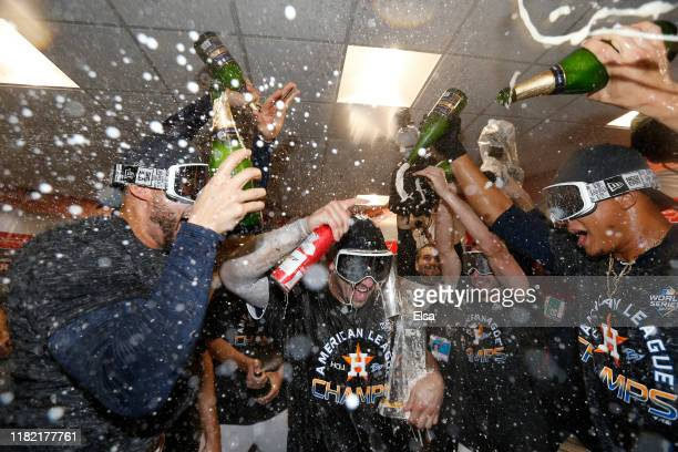 Alex Bregman of the Houston Astros celebrates with his teammates in the locker room following his team 64 win against the New York Yankees in game...