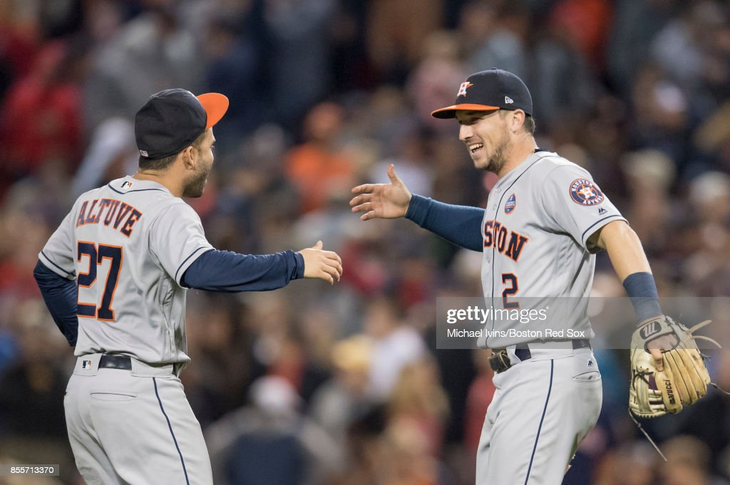 Alex Bregman #2 of the Houston Astros celebrates with Jose Altuve #27 after a 3-2 win over the Boston Red Sox at Fenway Park on September 29, 2017 in Boston, Massachusetts. Bregman had a home run and all three of Houston's runs batted in.