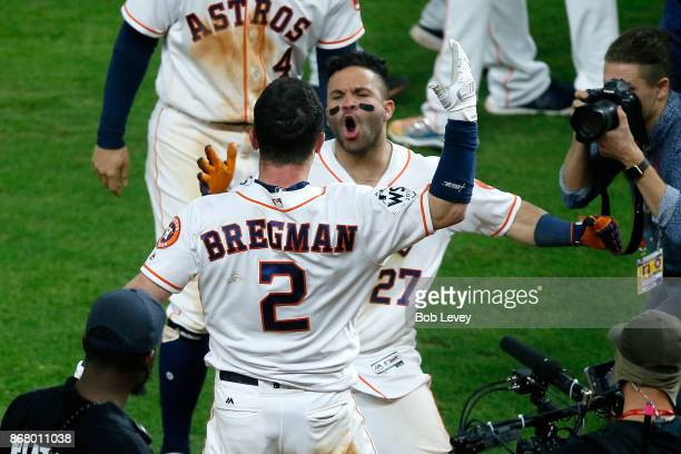 Alex Bregman of the Houston Astros celebrates with Jose Altuve after hitting the gamewinning single during the tenth inning to defeat the Los Angeles...