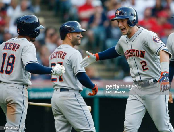 Alex Bregman of the Houston Astros celebrates with Jose Altuve and Tony Kemp after hitting a three run home run off Mike Clevinger of the Cleveland...