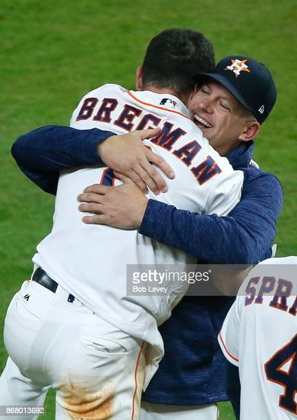 Alex Bregman of the Houston Astros celebrates with manager manager AJ Hinch after hitting the gamewinning single during the tenth inning to defeat...