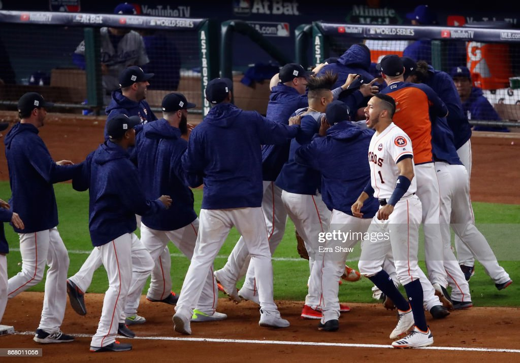 Alex Bregman #2 of the Houston Astros celebrates with teammates after hitting a game-winning single during the tenth inning against the Los Angeles Dodgers in game five of the 2017 World Series at Minute Maid Park on October 30, 2017 in Houston, Texas. The Astros defeated the Dodgers 13-12.