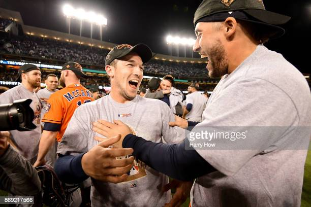 Alex Bregman of the Houston Astros celebrates with teammates after defeating the Los Angeles Dodgers 51 in game seven to win the 2017 World Series at...