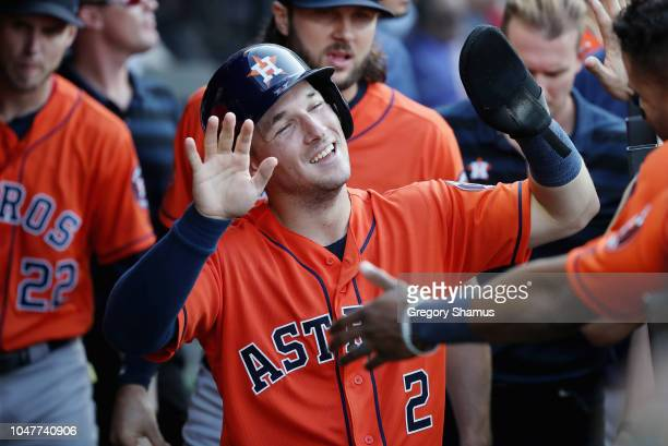 Alex Bregman of the Houston Astros celebrates with teammates in the dugout after scoring a run in the eighth inning against the Cleveland Indians...