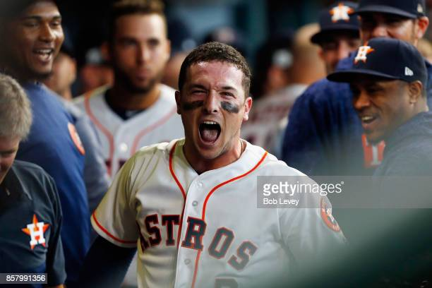 Alex Bregman of the Houston Astros celebrates with teammates in the dugout after hitting a home run in the first inning against the Boston Red Sox...