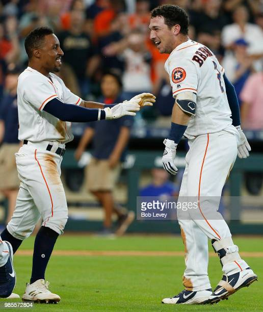 Alex Bregman of the Houston Astros celebrates with Tony Kemp after hitting a tworun walkoff home run in the ninth inning aToronto Blue Jays at Minute...