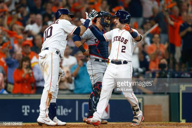 Alex Bregman of the Houston Astros celebrates with Yuli Gurriel after hitting a solo home run in the fourth inning against the Cleveland Indians...