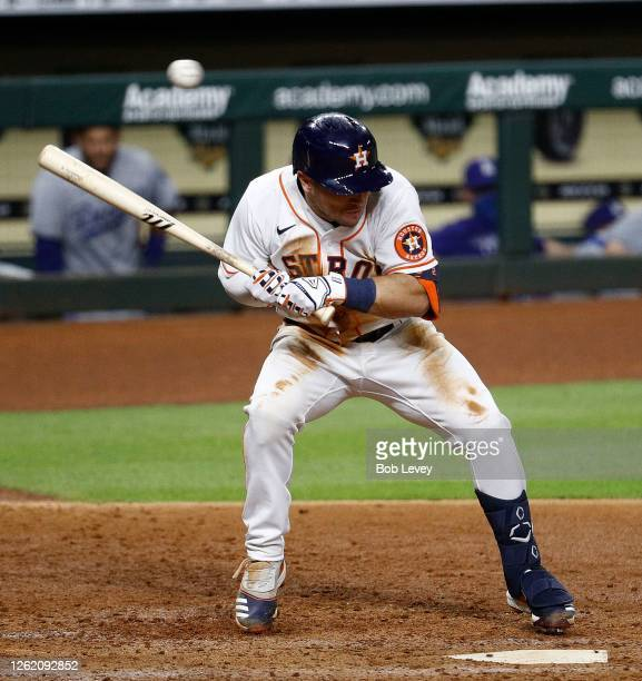 Alex Bregman of the Houston Astros ducks after a pitch from Joe Kelly of the Los Angeles Dodgers was thrown behind him in the sixth inning at Minute...