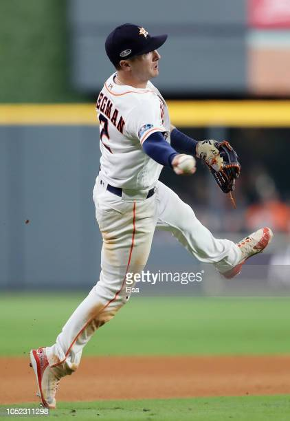 Alex Bregman of the Houston Astros fields a ball in the seventh inning against the Boston Red Sox during Game Three of the American League...
