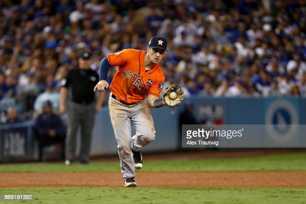 Alex Bregman of the Houston Astros fields a ground ball during Game 7 of the 2017 World Series against the Los Angeles Dodgers at Dodger Stadium on...