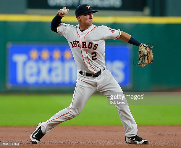 Alex Bregman of the Houston Astros fields a ground ball off the bat of Danny Valencia of the Oakland Athletics in the first inning at Minute Maid...
