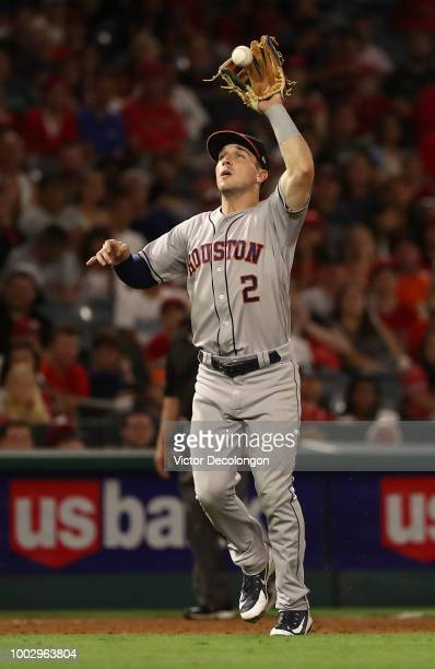 Alex Bregman of the Houston Astros fields a high ground ball in at third base in the eighth inning during the MLB game against the Los Angeles Angels...