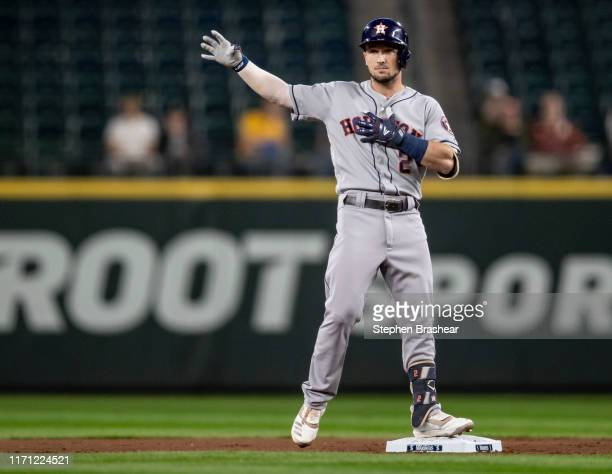 Alex Bregman of the Houston Astros gestures toward the dugout after hitting a RBI-double off of starting pitcher Yusei Kikuchi of the Seattle...