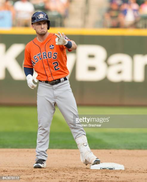 Alex Bregman of the Houston Astros gestures toward the dugout after hitting a tworun double off of relief pitcher Nick Vincent of the Seattle...