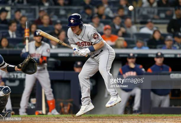 Alex Bregman of the Houston Astros hit by a pitch against the New York Yankees in game three of the American League Championship Series at Yankee...