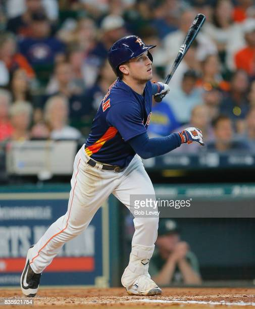Alex Bregman of the Houston Astros hits a a sacrifice fly in the third inning to score Jake Marisnick from third base at Minute Maid Park on August...