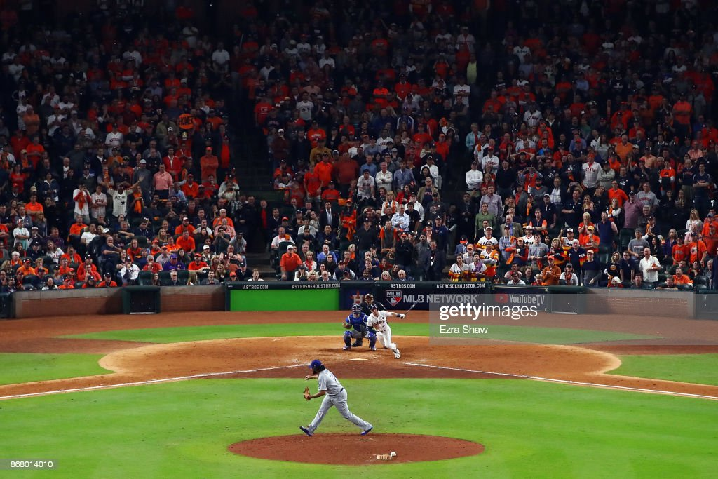 Alex Bregman #2 of the Houston Astros hits a game-winning single during the tenth inning against Kenley Jansen #74 of the Los Angeles Dodgers in game five of the 2017 World Series at Minute Maid Park on October 30, 2017 in Houston, Texas.