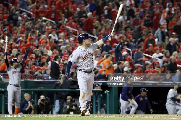 Alex Bregman of the Houston Astros hits a grand slam home run against the Washington Nationals during the seventh inning in Game Four of the 2019...