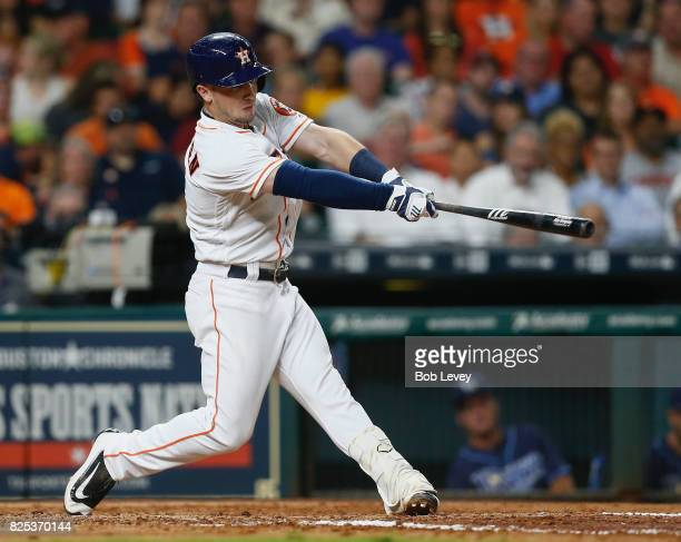 Alex Bregman of the Houston Astros hits a home run in the fifth inning against the Tampa Bay Rays at Minute Maid Park on August 1 2017 in Houston...