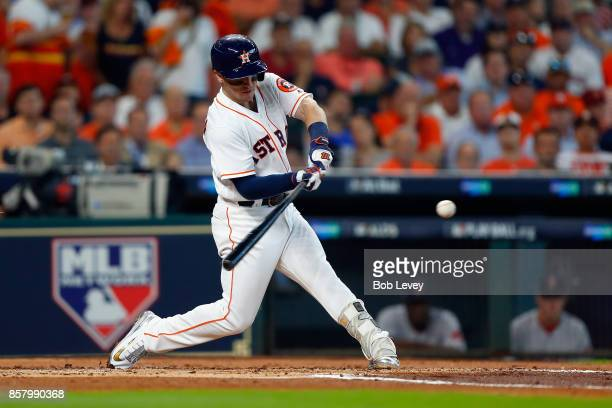 Alex Bregman of the Houston Astros hits a home run in the first inning against the Boston Red Sox during game one of the American League Division...