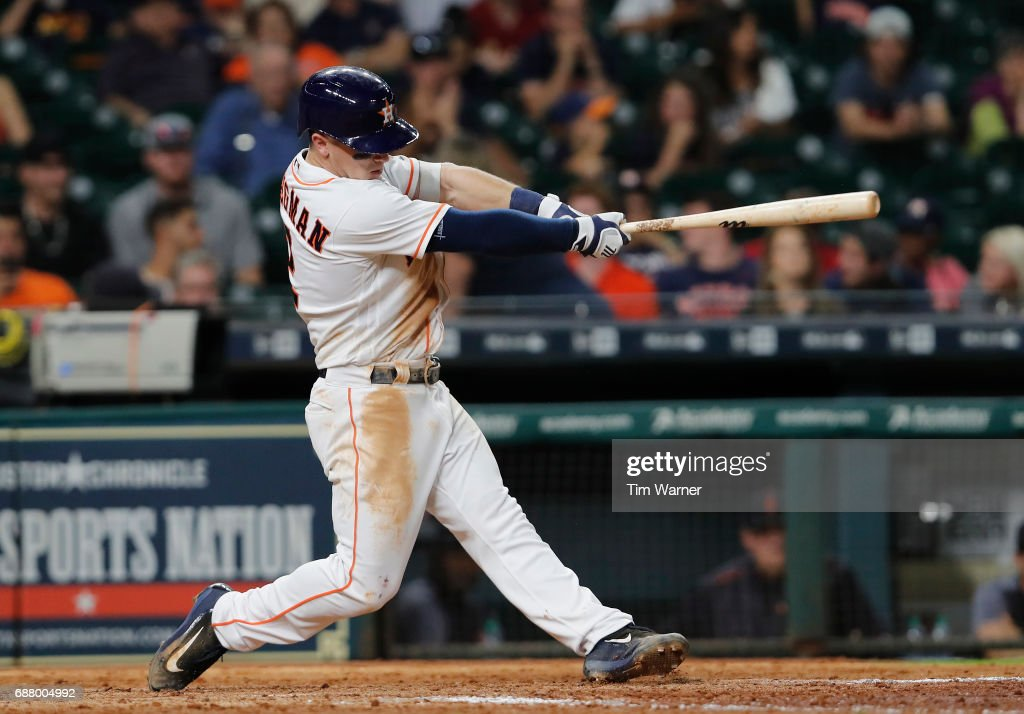 Alex Bregman #2 of the Houston Astros hits a home run in the ninth inning against the Detroit Tigers at Minute Maid Park on May 24, 2017 in Houston, Texas.