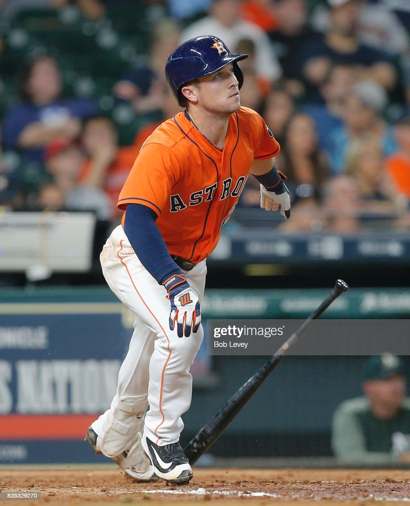 Alex Bregman #2 of the Houston Astros hits a home run in the third inning against the Oakland Athletics at Minute Maid Park on August 18, 2017 in Houston, Texas.